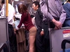Japanese whore sucks dick in a public bus